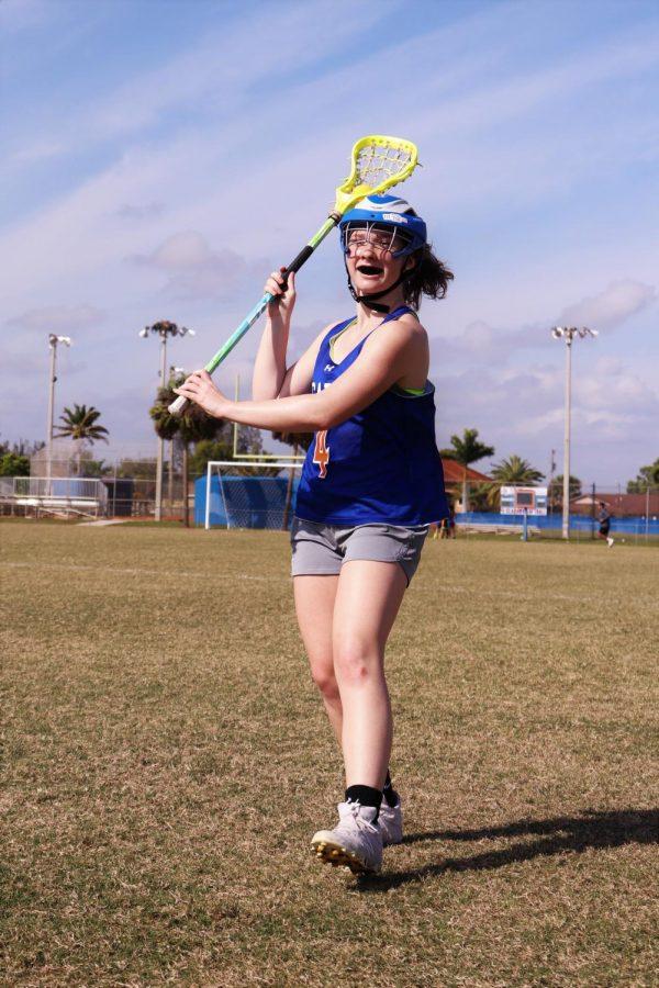 Moving Forward: Bridget Wawrzyniak prepares to pass the ball.