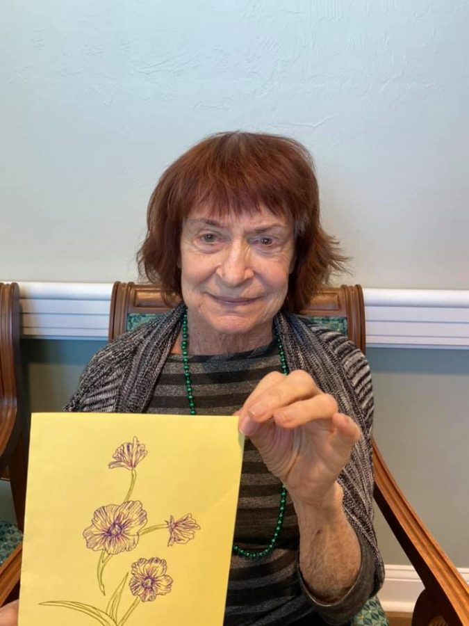 Resident of Gulf Coast Village receives their card.