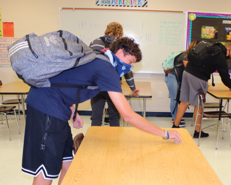 Students follow contact tracing procedures by sitting in their socially distanced assigned seats and cleaning them at the end of class.