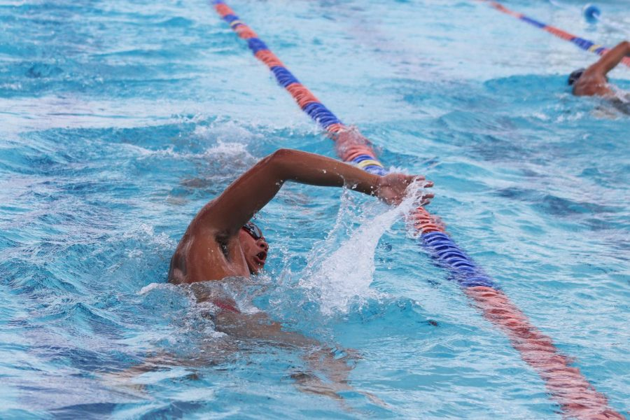 Kelvin Manzano practices his freestyle while also remaining a safe distance from his peers.