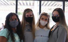 Jazmine Fajardo, Kendall Hannan, Mia Johnson, and Carolina Espejo pictured wearing masks at school.