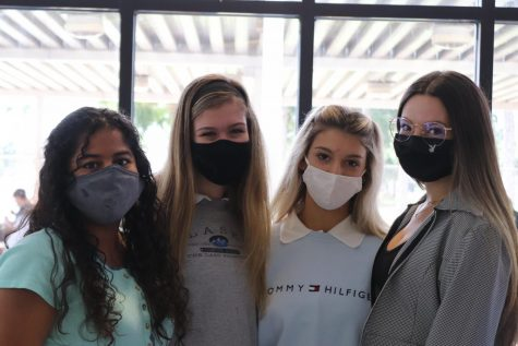 Jazmine Fajardo, Kendall Hannan, Mia Johnson, and Carolina Espejo pictured wearing masks at school.