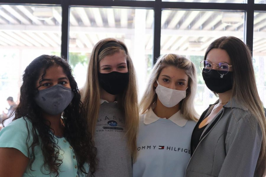 Jazmine+Fajardo%2C+Kendall+Hannan%2C+Mia+Johnson%2C+and+Carolina+Espejo+pictured+wearing+masks+at+school.