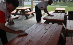 Cape High administration cleans tables during lunch periods.