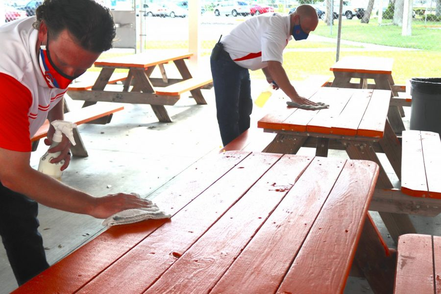 Cape High Administration wipes down tables during lunch periods.