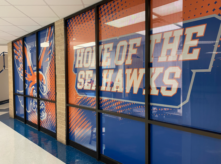 A Bold Enterance: Principal Englehart's office windows re-vamped over the summer and filled with optimistic school spirit